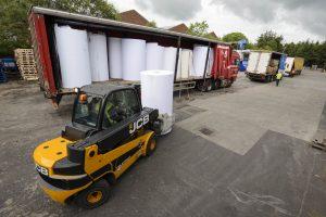 Loading paper reels